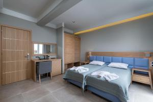 A bed or beds in a room at Argiri Resort Hotel & Apartments