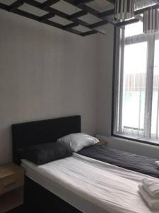 Un ou plusieurs lits dans un hébergement de l'établissement 2 Sides