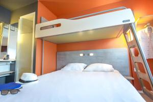 A bunk bed or bunk beds in a room at ibis budget Marseille L'Estaque
