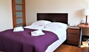 Łóżko lub łóżka w pokoju w obiekcie Villa Parnas Old Town
