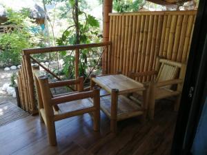 A balcony or terrace at Big BamBoo Beach Resort Sipalay