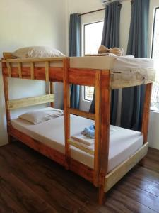 A bunk bed or bunk beds in a room at Big BamBoo Beach Resort Sipalay