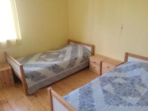 Voodi või voodid majutusasutuse Veski Spordi- ja Puhkekeskus toas