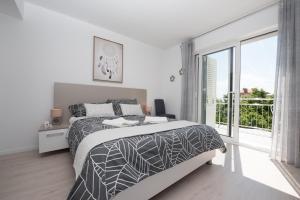 Łóżko lub łóżka w pokoju w obiekcie Villa Lorenzo