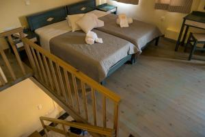 A bed or beds in a room at Ekosuites