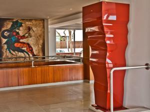De lobby of receptie bij BQ Apolo Hotel