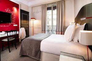 Un ou plusieurs lits dans un hébergement de l'établissement Edouard 7 Paris Opéra