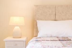 A bed or beds in a room at MarGreCo in Garitsa