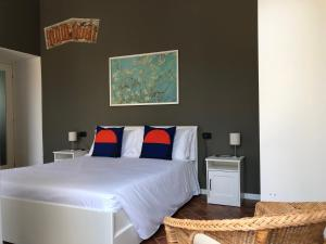 A bed or beds in a room at Aparthotel Arona