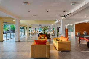 The lobby or reception area at Cocobay Unawatuna