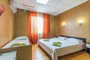 Кровать или кровати в номере Гостиница Мельница