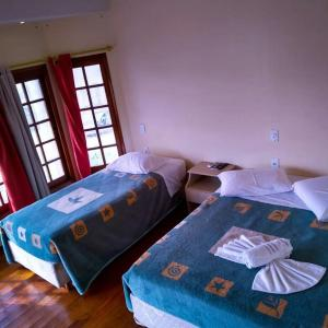 A bed or beds in a room at Hotel Solare