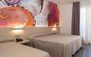 Een bed of bedden in een kamer bij Hotel Riviera