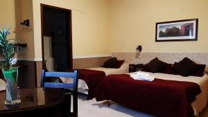 A bed or beds in a room at Hotel Rivera