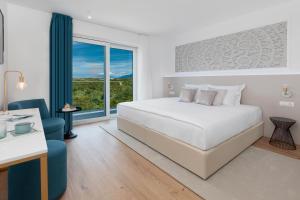 Letto o letti in una camera di Hotel In Excelsis