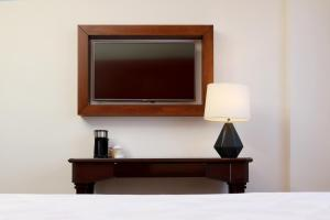 A television and/or entertainment center at Holiday Inn Hotel & Suites Centro Historico, an IHG Hotel