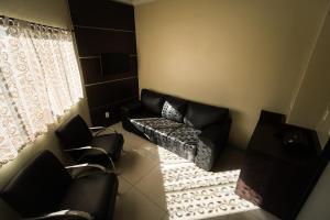 Uma área de estar em Hotel Campo Verde
