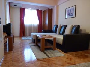 Posedenie v ubytovaní Adeona Apartments