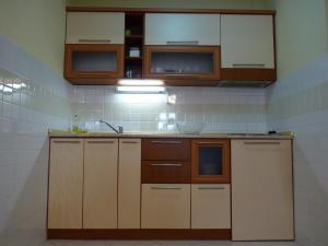 Kuchyňa alebo kuchynka v ubytovaní Adeona Apartments