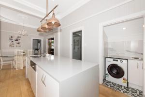 A kitchen or kitchenette at Beautiful Queenslander