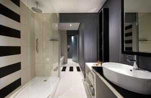 A bathroom at Protea Hotel Fire & Ice! by Marriott Johannesburg Melrose Arch