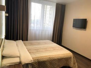 Кровать или кровати в номере East Residence