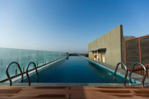 The swimming pool at or near DoubleTree by Hilton Ahmedabad