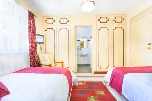 A bed or beds in a room at Methodist Resort