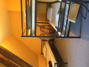 Un ou plusieurs lits superposés dans un hébergement de l'établissement Auberge de jeunesse-La Hulotte