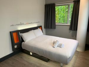 A bed or beds in a room at easyHotel Milton Keynes