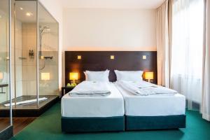 Ein Bett oder Betten in einem Zimmer der Unterkunft Flemings Hotel München-City