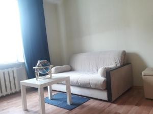 A seating area at Квартира на Мосфильмовском