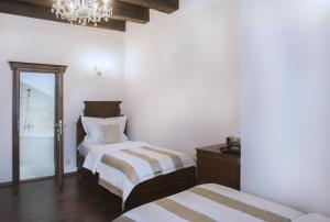Cama o camas de una habitación en Grand Hotel Praha