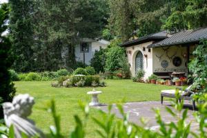 Jardín al aire libre en Hotel Garni Haus Arenberg