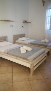 A bed or beds in a room at Hotel Harama