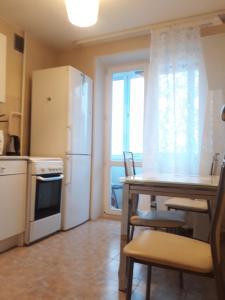 A kitchen or kitchenette at Квартира на Мосфильмовском