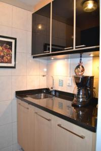 A kitchen or kitchenette at Fontana: Location + Pool