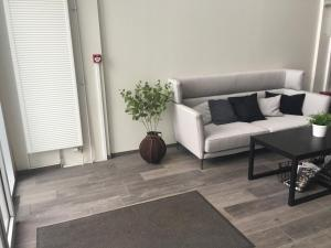 A seating area at Bella Apartments & Rooms
