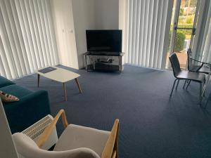 A television and/or entertainment center at Aquarius Apartments Mollymook