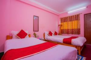A bed or beds in a room at Sunrise Moon Beam Hotel