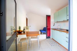 A kitchen or kitchenette at Albergo Residenziale Stella Dell'Est