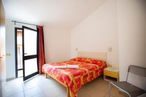 A bed or beds in a room at Albergo Residenziale Stella Dell'Est