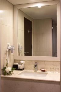 A bathroom at Atria Hotel Malang
