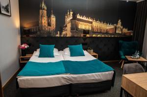 Łóżko lub łóżka w pokoju w obiekcie Hotel Pod Wawelem