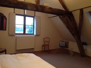 A bed or beds in a room at Geldmunt Apartment
