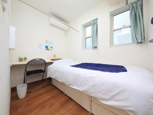 A bed or beds in a room at セカンドハウスのようなプライベート宿 東京平和島 T House