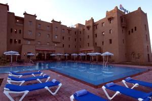 The swimming pool at or near Ibis Ouarzazate