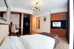 Łóżko lub łóżka w pokoju w obiekcie Hotel&Spa Kameleon