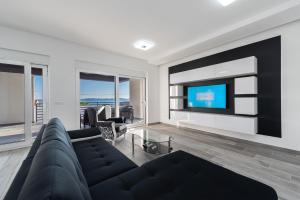 A seating area at Villa Barbara-holiday home with sea view