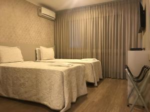Cama ou camas em um quarto em Realce Hotel